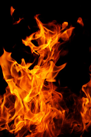 red flames of fire as red black backgorund photo