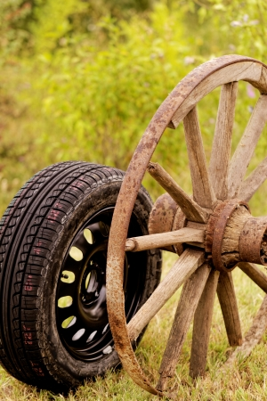 new and old broken wagon (car) wheel Stock Photo - 22747030