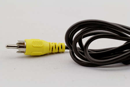 only yellow video RCA cable on a white background photo