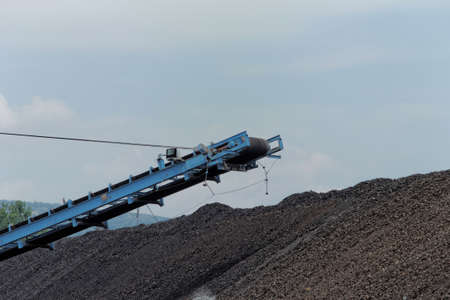 tailings: Coal mining in an open pit with huge industrial machine