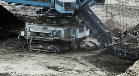 chiming: Coal mining in an open pit with huge industrial machine
