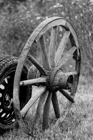 new and old broken wagon (car) wheel Stock Photo - 22881786