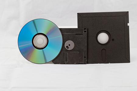 dvdrw: Old Fashion Floppy Disc and Compact Disc ( DVD, CD, CD-RW, DVD-RW ) Stock Photo