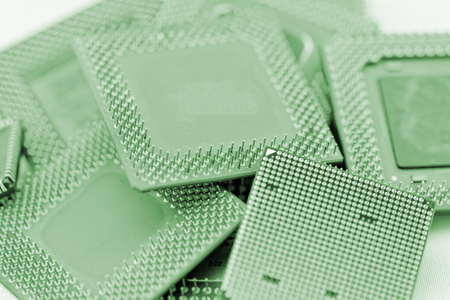 processors: close up of many different cpu processors in green Stock Photo