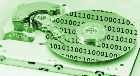 internals: Internals of a computer harddrive with binary number reflections with green colors (HDD, winchester)