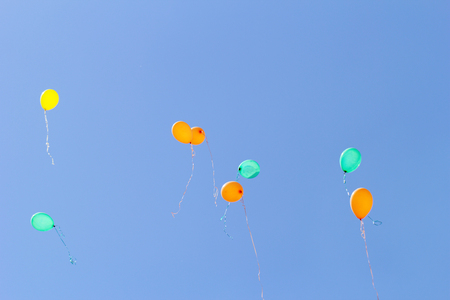 color balloons flying to the sky photo