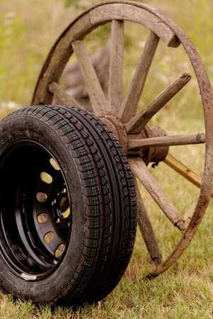 new and old broken wagon (car) wheel Stock Photo - 23431483