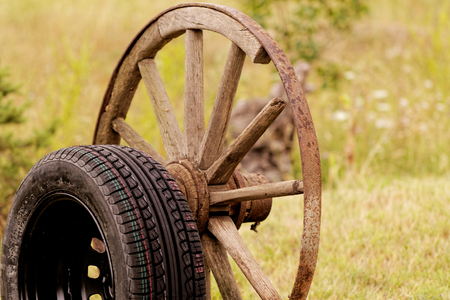 new and old broken wagon (car) wheel Stock Photo - 23431484