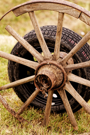 new and old broken wagon (car) wheel Stock Photo - 23431486