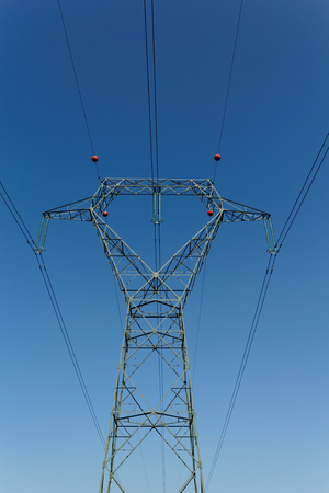 Detail of electricity pylon against blue sky  photo