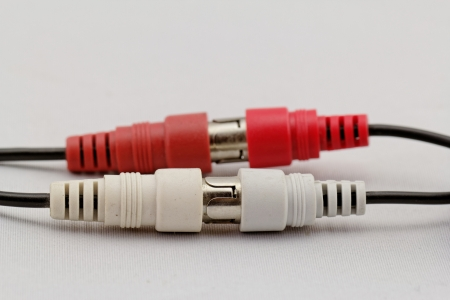 correct conection between left - right audio RCA cable on a white background (red white) photo