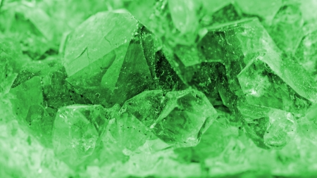 Close up picture about a crystal with emerald color on white background (green crystal) Stock Photo - 23698904
