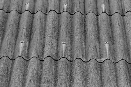 slate roof: monochrome texture of gray corrugated slate roof Stock Photo