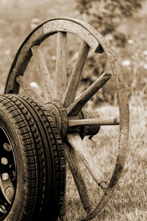 new and old broken wagon (car) wheel Stock Photo - 23699085