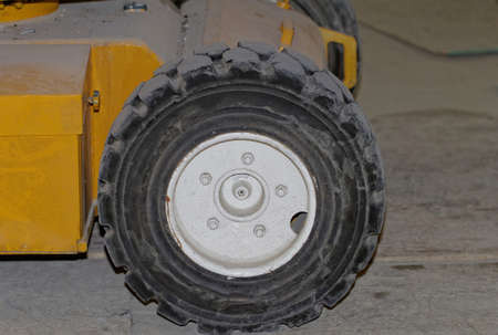 Yellow industrial machine with solid rubber wheel photo
