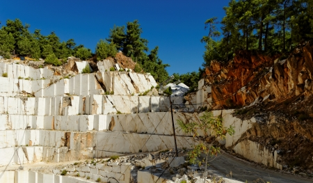 Detail of huge Thassos white marble quarry (mine) with grabber photo
