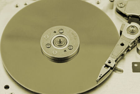 databank: Open computer hard drive on white background with rusty color (HDD, Winchester)