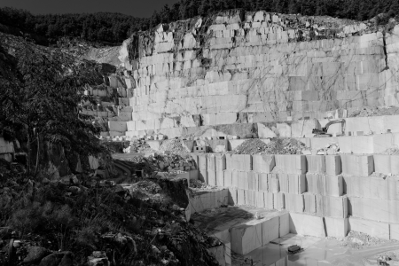 sand quarry: Detail of huge Thassos white marble quarry (mine) with grabber in bw color