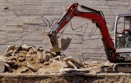 the excavator working on a construction site Stock Photo
