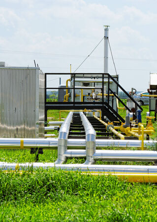 industrial pipes at an oil well photo