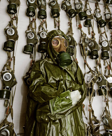 old military gas masks on a soldier woman with chemical protective suit photo