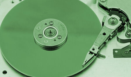 databank: Open computer hard drive on white background with green (HDD, Winchester)