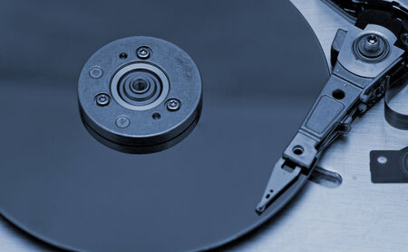 databank: Open computer hard drive on white background with blue (HDD, Winchester)