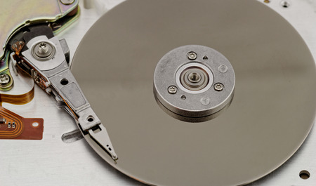 Open computer hard drive on white background (HDD, Winchester) photo