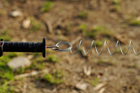 electric fence: Close up photo of an electric fence