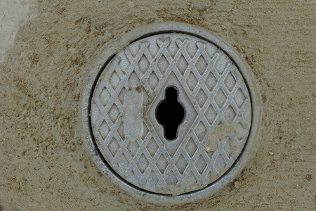 Close up photo of a gray outdoor faucet cover photo