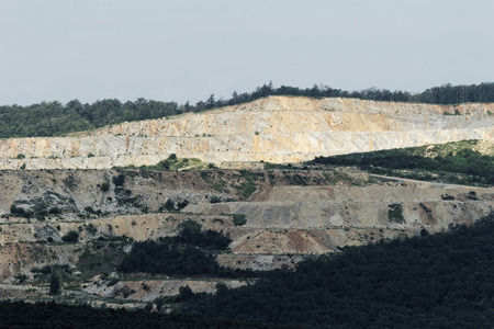 Lowering photo of a big stone pit photo