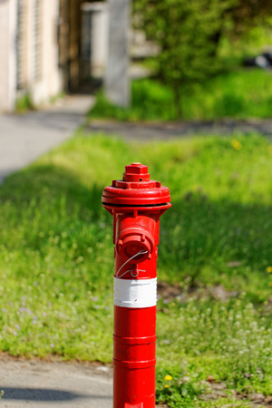 red fire hydrant on the sidewalk Stock Photo