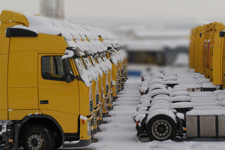 Landscape lot of yellow snowy trucks Stock Photo