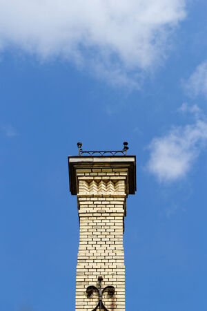 Photo of a high steeple, background is the blue sky