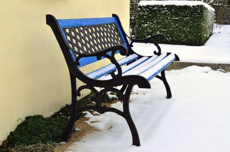 Blue and old abandoned bench for the winter garden