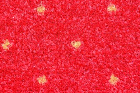 synthetic fiber: Red synthetic fiber carpet with yellow dots Stock Photo