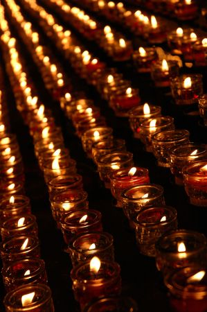 Rows of votive candles in church