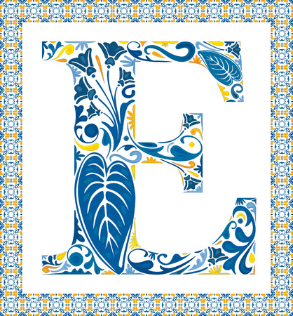 Blue floral capital letter E in frame made of Portuguese tiles