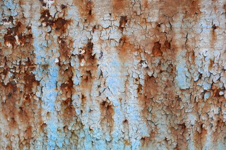 Close up of texture of old cracked rusted painted door