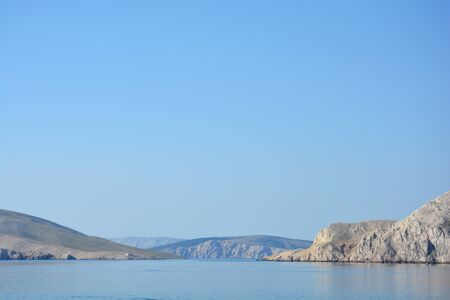 View from island Krk towards islands Prvic, St. Grgur and Rab, Croatia early in the morning Stock Photo