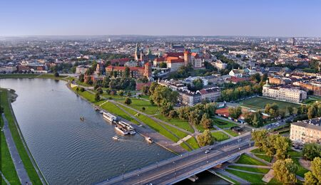 wawel: Cracow panorama with Wawel castle and Vistula river. Aerial view at sunset. Stock Photo
