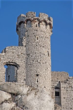 ogrodzieniec: Old stone tower on the rock in the ruins of the castle Ogrodzieniec, Poland.