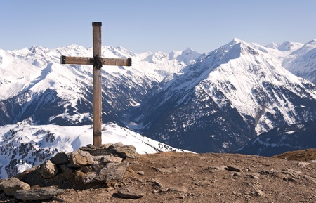 Wooden cross with the head of Jesus Christ on the top of the Ahorn mountain near Mayrhofen  in the Zillertal Alps in Austria photo