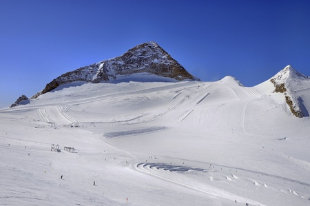moguls: Hintertux Glacier in Zillertal Alps in Austria with ski runs, pistes and ski lifts.