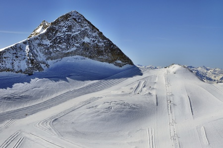 moguls: Hintertux Glacier in Zillertal Alps in Austria with ski runs, pistes and ski lifts  Stock Photo