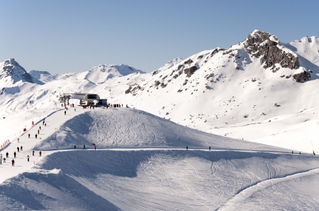Top chairlift station, skiers and ski pistes in Zillertal Alps near Mayrhofen in Tirol, Austria photo