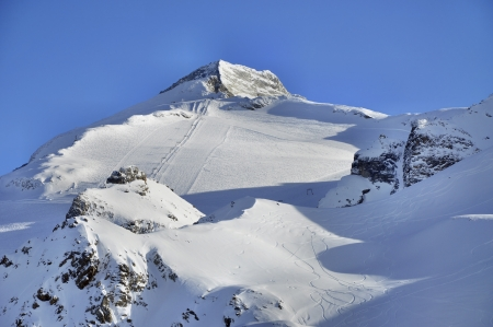 ski track: Hintertux Glacier in Zillertal Alps in Austria with ski runs, pistes and ski lifts at sunset light