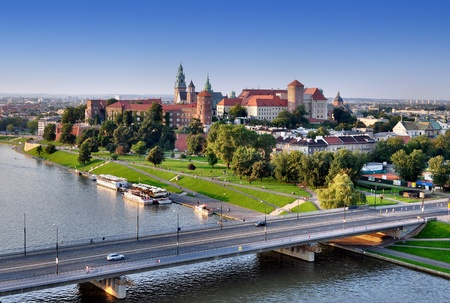 Cracow panorama with Wawel castle, Vistula river and Grunwaldzki bridge  Aerial view at sunset
