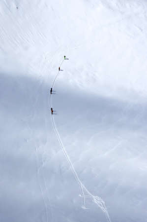 wanderers: A group of skiers wandering across a glacier in Austrian Alps Stock Photo