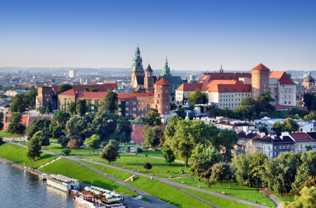 Historic royal Wawel castle in Cracow, Poland with park and Vistula river  Aerial view at sunset